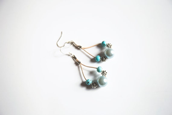 Handmade earrings on suede, with beads, gemstones, and sterling silver / brass earwires.