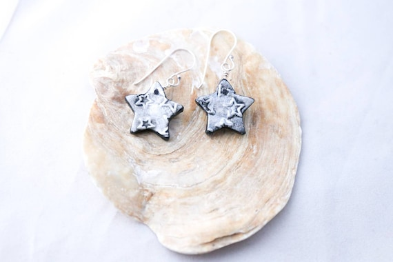Hand modelled star shaped earrings, embossed with stars, sterling earwires
