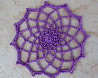 small purple round crochet doily