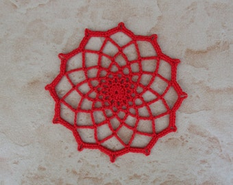 small red round crochet doily