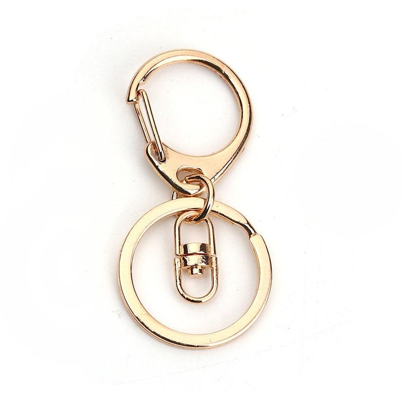 SC0108835- 40 Muskets Key Door Gold Metal Bag Jewelry 67x30mm