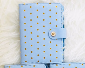 Notebook diary in light blue with golden dots