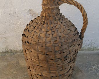 Glass vintage demijohn, in wicker protection