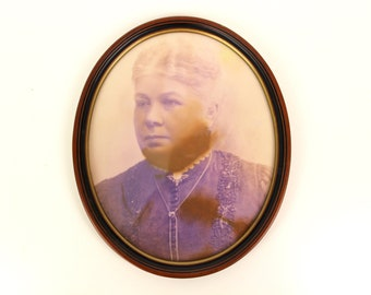 Vintage photography in oval wooden frame
