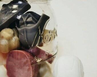 Mason jar of assorted wax melts