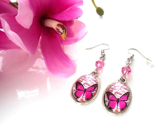Pink Swarovski glass cabochon with a butterfly on a romantic background of Scripture and Crystal bead earrings