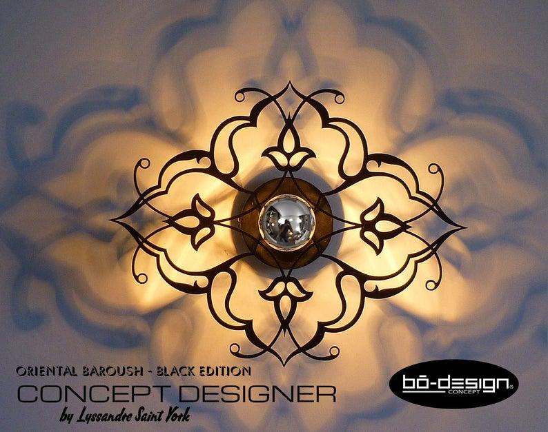 Applique murale design en métal perforé doré et noir trento