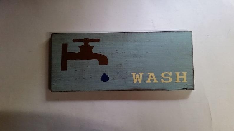 rusti wood sign bathroom