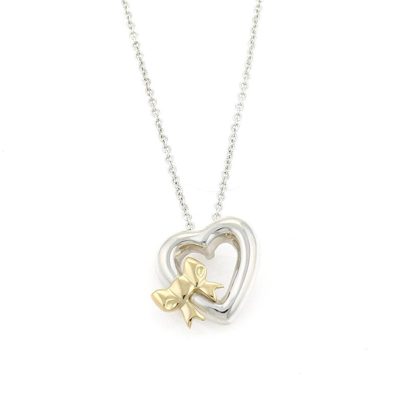 1432092d704 Tiffany   Co. 1990 Sterling 18k Yellow Gold Heart Bow Pendant
