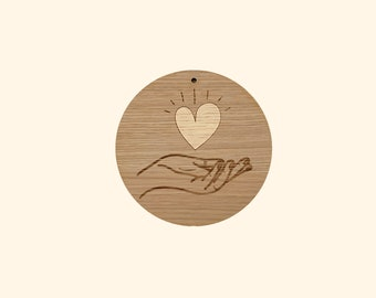 Heart wooden wall decoration on hand