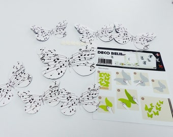 7 deco stickers soaring Butterfly embossed music score in black and white pvc 7 different sized butterfly notes