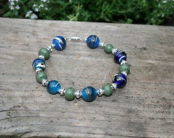 Bracelet made of handmade glass beads, combined with various metal elements