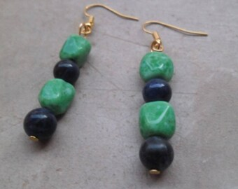 Earrings dangle with vintage stone beads and ceramic