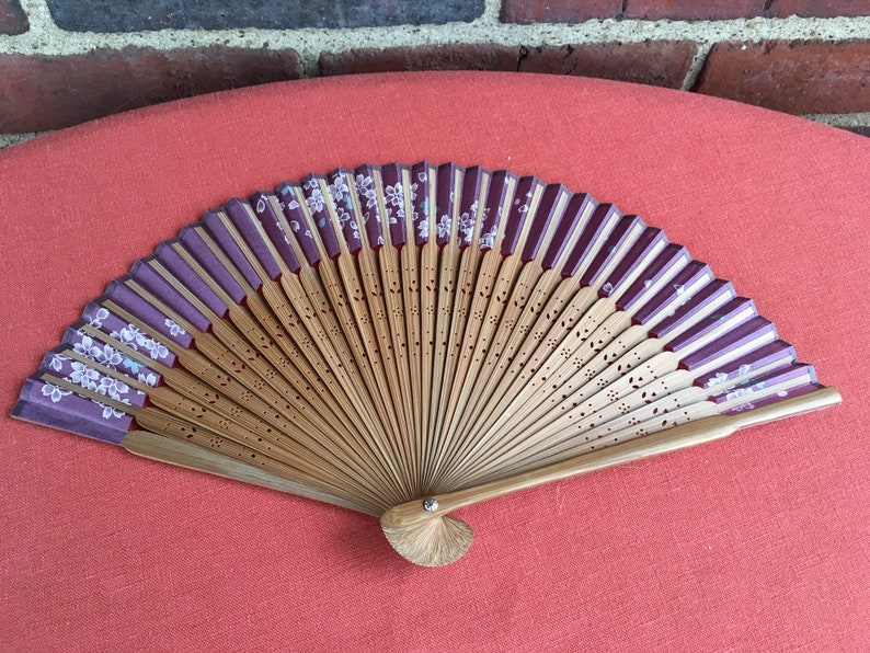 plum colored fabric with white flowers vintage 1970s Chinese hand fan