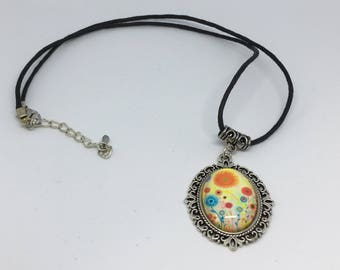 Colourful flower pendant on a black cord Handmade