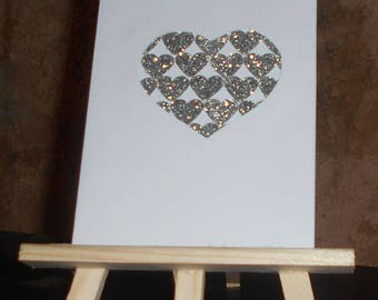 Card heart filled with silver glitter hearts