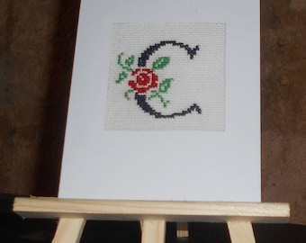 Embroidered card on canvas with a floral initial with a rose