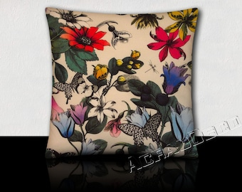 Square cushion butterflies and multicoloured tulips fuchsia/orange/yellow/blue/purple/green imperial/black on white background.