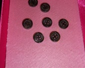 Plain grey round buttons ...