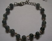 Bracelet grey glass beads...