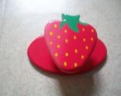 Strawberry coat rack...