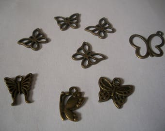 A set of eight Butterfly charms