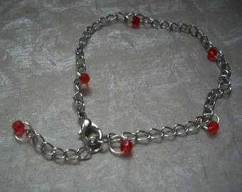 Bracelet metal and Red faceted beads