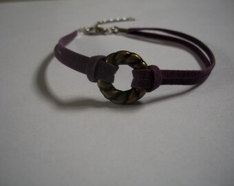 Ring and purple suede bracelet