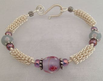 Silver wirework bracelet, with pale lilac floral lampwork beads