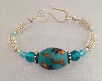 Silver wirework bracelet, with turquoise lampwork focal bead.
