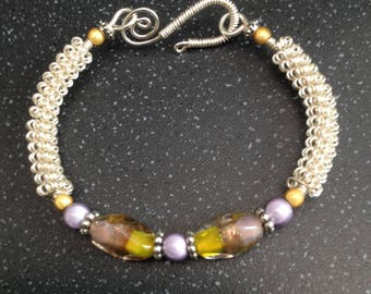 Silver wirework bracelet, with yellow and lilac lampwork focal beads.