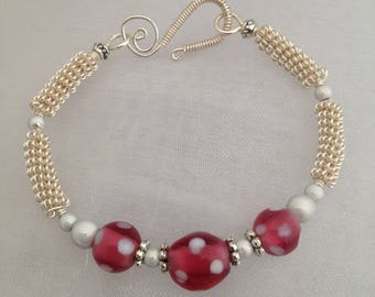 Silver wirework bracelet, with pink and white lampwork beads.