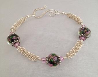 Silver wirework bracelet, with glass lampwork beads.