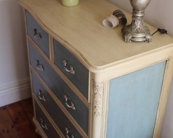 SOLD.      French Provincial hand painted large solid dresser