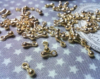 x 100 charms drops in Golden brass.