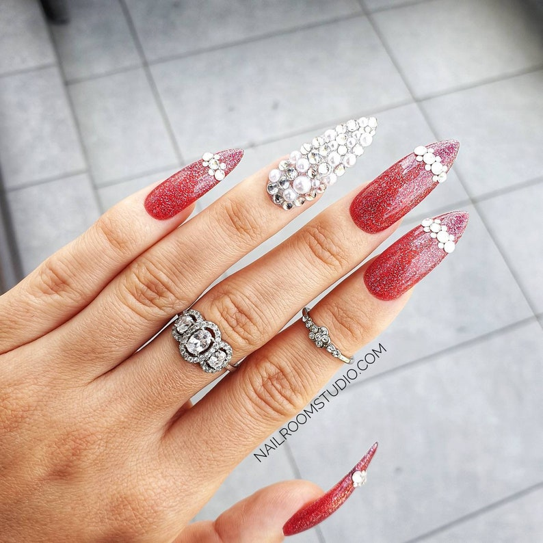 10 false nails  glossy jelly red with pearls and silver image 0
