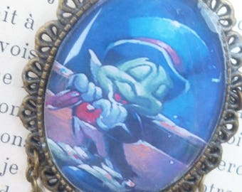Magical cricket oval brooch