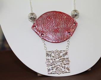 Red necklace made of polymer and silver leaves with pearls and filigree