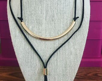 Black choker with gold elements