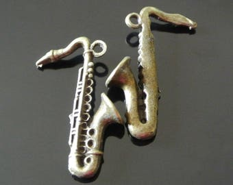 A pair of pretty charms bronze saxophone 36 x 24 x 8 mm, musical instrument in bronze color metal, hangs about 2 mm hole