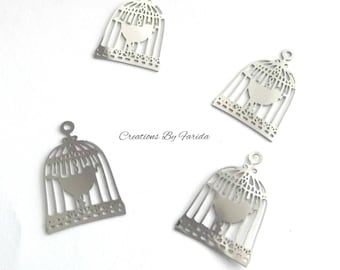 set of 4 prints, thin and lightweight bird in a cage