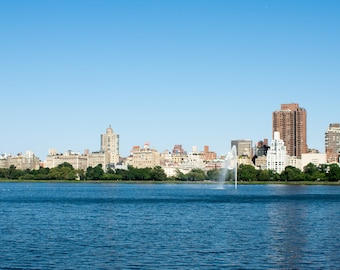 City Skyline as seen from across the Lake in Central Park in New York City, Cityscape, Urban Skyline with blue tones
