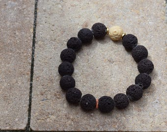 10 mm lava stone vitality bracelet with single carved bone accent