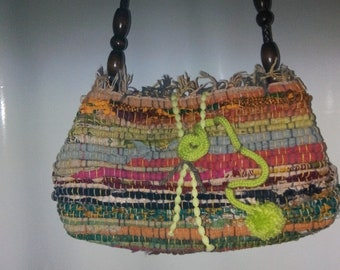 A multi color cross body purse