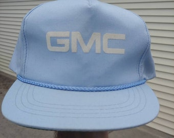 6df9cf15c1acd 80s 90s GMC logo graphic baby blue ball cap trucker hat strapback  adjustable vtg vintage cars trucks