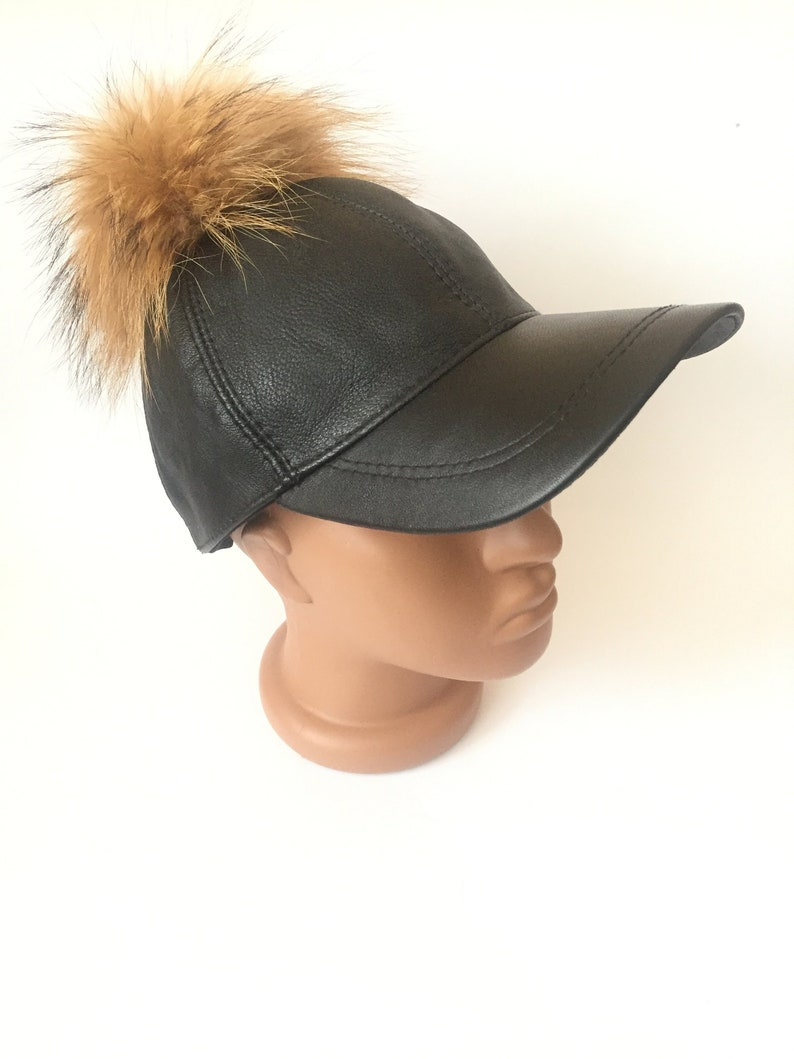 c69530a00a0 Women s Black leather baseball cap with a real fur pompom