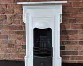 Image of Complete cast iron bedroom fireplace. fire surround. Cast iron fire complete