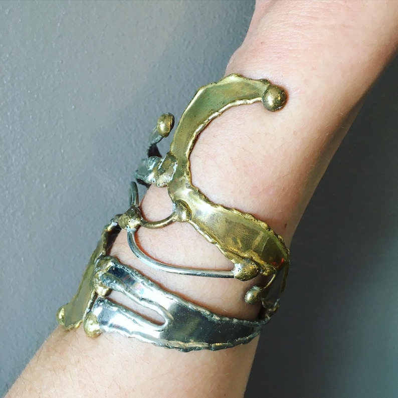 Unique piece and adjustable to all wrists Like an abstract sculpture Open cuff bracelet in goldsilver metal