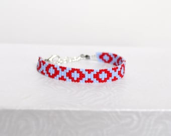Bright red and pale blue woven bracelet