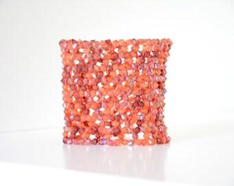 Hand woven red orange bracelet